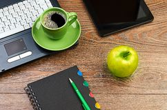 Green apple on worplace Royalty Free Stock Photo