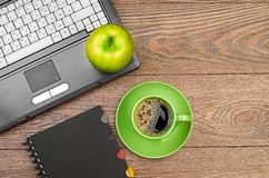 Green apple on worplace Stock Photos