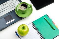 Green apple on worplace Royalty Free Stock Images