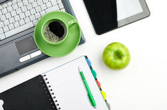 Green apple on worplace Stock Image