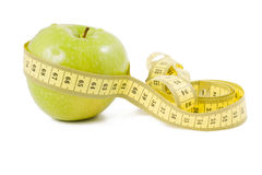 Green apple wrapped in centimetre Stock Photos