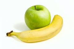 Green apple and  yellow banana. Green apple and ripe yellow banana isolated on white background Stock Photo