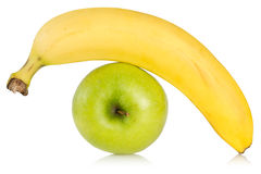 Green apple and yellow banana Royalty Free Stock Photography