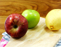 Green apple yellow chinese pear and red apple Stock Photography