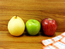 Green apple yellow chinese pear and red apple Stock Images