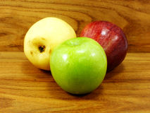Green apple yellow chinese pear and red apple Royalty Free Stock Images
