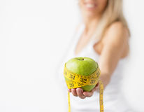 Green apple with yellow measurement tape Royalty Free Stock Photography