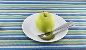 Green apple and yellow measuring tape concept for healthy diet a Stock Photo