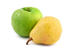 Green apple and yellow pear Stock Images