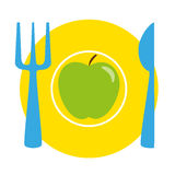 Green apple on the yellow plate with blue fork and knife Stock Photos