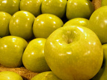 Green Apples. Shot of fresh green apples in a supermarket - focus mainly on the apple in front stock photo