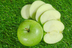 Green Apples. Green Apple And Apple Slices On Green Grass Royalty Free Stock Image
