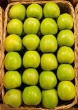 Green apples. Ripe green apples in a basket Royalty Free Stock Photo