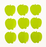 Green apples. Background from green apples of colored  paper Royalty Free Stock Photography
