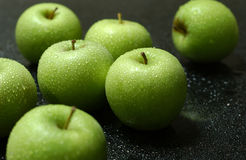 Green apples. Fresh green apple and water drop on top of marble surface royalty free stock images