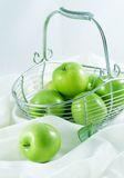 Green Apples. In the basket Stock Photography