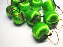 Green apples 5. Green satin Christmas apples on the grey background stock photo