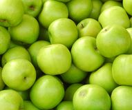 Green apples. Overlapping Fresh green apple background Royalty Free Stock Photography