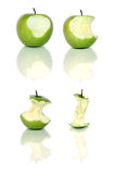 Green apples. Four green apples and apple cores over white Royalty Free Stock Image