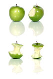 Green apples. Four green apples and apple cores over white Stock Image