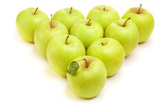 Green apples. Green isolated apples in a triangle shape Stock Images