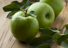 Green apples. On wood background Stock Image