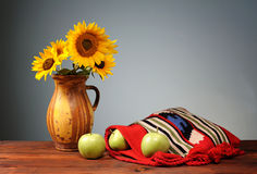 Green apples in abag with a flower vase Stock Image