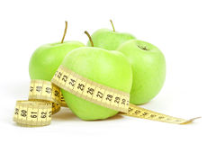 Green Apples And Measuring Tape Isolated On White Background Royalty Free Stock Photography