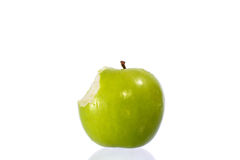 Green apples. Green apple missing a bite isolated on a white background stock photos