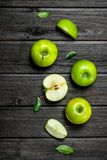 Green apples and Apple slices. On a dark wooden background stock photos