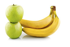 Green apples and bananas Stock Photo