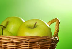 Green apples in basket Stock Images