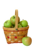 Green Apples In A Basket Over White. Apples in a basket isolated Royalty Free Stock Images