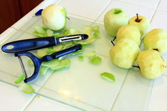 Green Apples being Peeled for baking. Apples being prepared for baking Stock Image