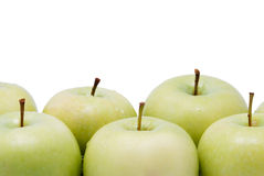Green apples in the bottom of the image Royalty Free Stock Photos