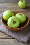 Green apples in a bowl on napkin Stock Photos