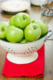 Green apples in a colander. Royalty Free Stock Photography