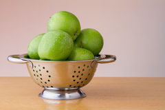 Green apples in a colander Stock Photography