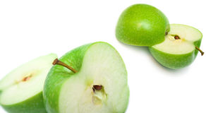 Green apples cut on a part Stock Photography