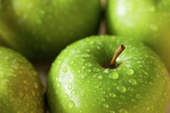 Green apples with dew drop close up Stock Photography