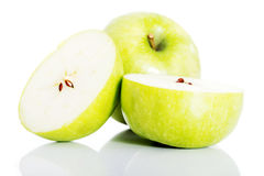 Green apples divided on two half. Royalty Free Stock Photos