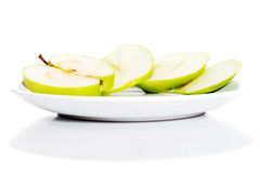 Green apples divided into two half. Royalty Free Stock Photos
