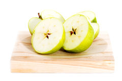 Green apples divided into two half. Stock Images