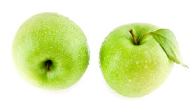 Green apples in drops of water Royalty Free Stock Photography
