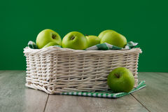 Green apples on emerald Royalty Free Stock Photo