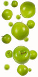 Green apples falling. Green apples shot as if falling from above with blur added to simulate depth Stock Images