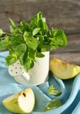Green apples and fresh mint Stock Photography