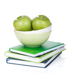 Green apples in fruit bowl and books Royalty Free Stock Photography
