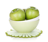 Green apples in fruit bowl Stock Photos