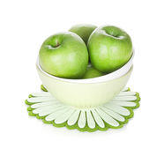 Green apples in fruit bowl Stock Images